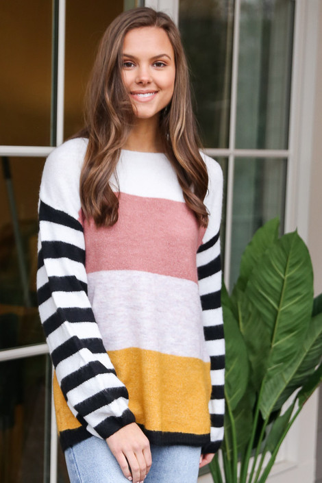Model wearing the Oversized Color Block Knit Top with light wash jeans from Dress Up Front View