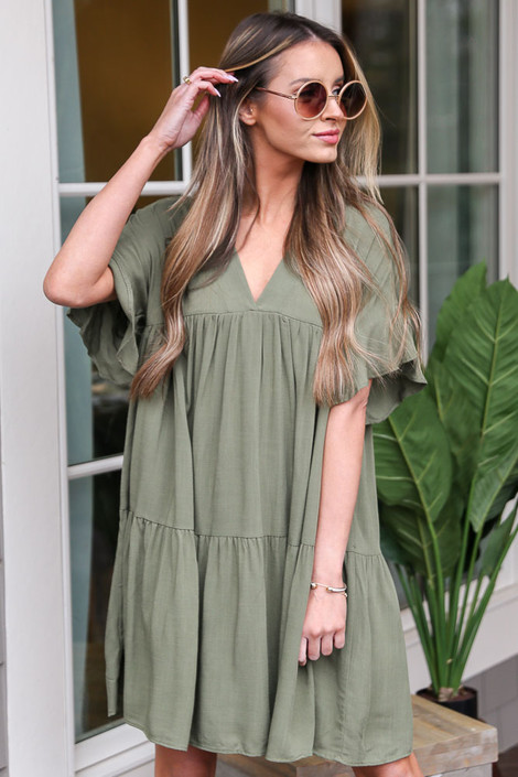 Dress Up model wearing the Tiered Babydoll Dress in Olive