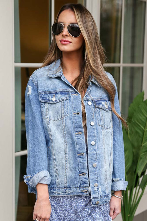 Dress Up model wearing the Distressed Denim Jacket in Medium Wash with a blue skirt and aviator sunglasses