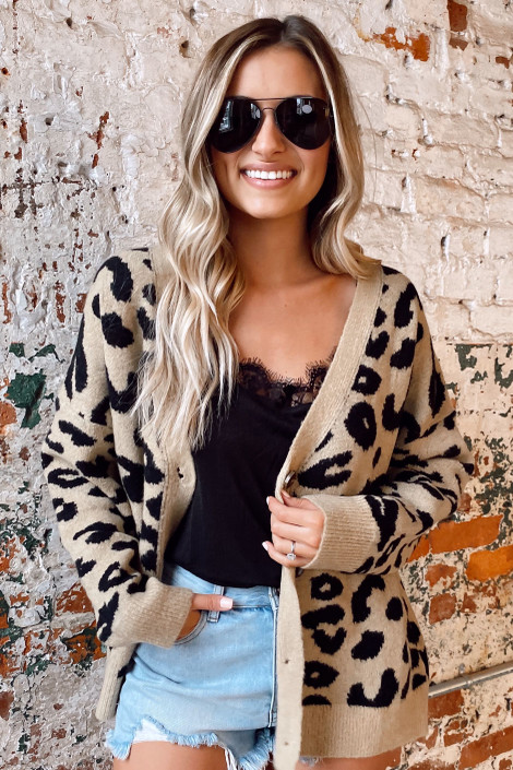 Model wearing the Leopard Luxe Knit Sweater Cardigan with denim shorts from Dress Up
