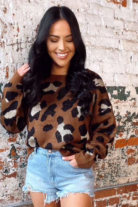 Model wearing the Brown Leopard Print Knit Top with high rise denim shorts from online dress boutique
