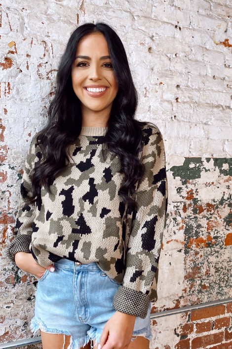 Model wearing the Camo Luxe Knit Top from Dress Up Boutique