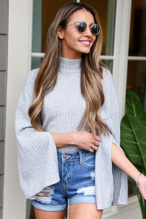 Model wearing the Grey Mock Neck Statement Sleeve Top from Dress Up