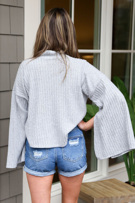 Model wearing the Grey Mock Neck Statement Sleeve Top from Dress Up Back View