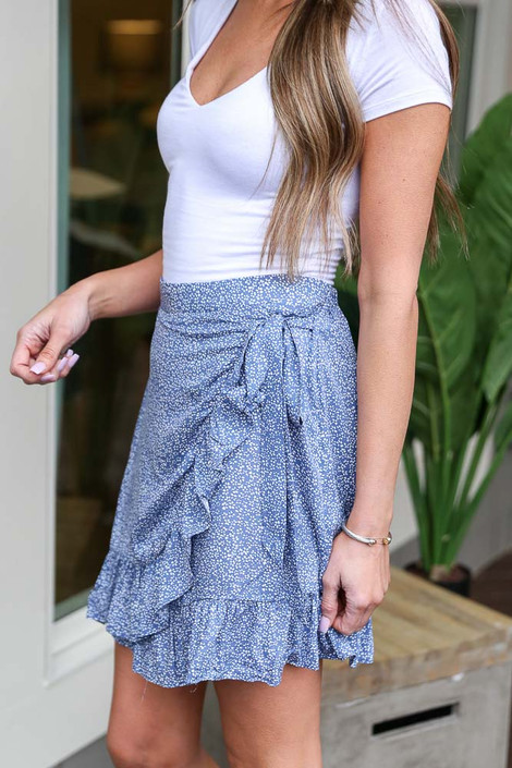 Model wearing the Floral Wrap Skirt in Blue with white tee from Dress Up Close Up Side View