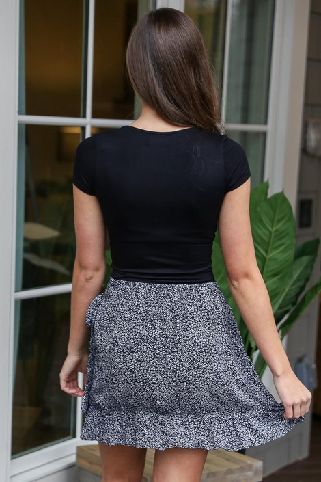 Model wearing the Floral Wrap Skirt with Black bodysuit from Dress Up Back View