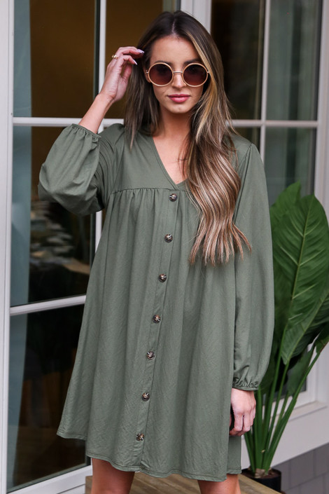 Olive - Model wearing the V-Neck Button Front Babydoll Dress with sunglasses