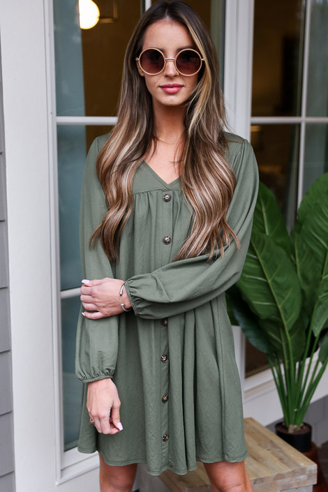 Olive - Dress Up model wearing the V-Neck Button Front Babydoll Dress with sunglasses