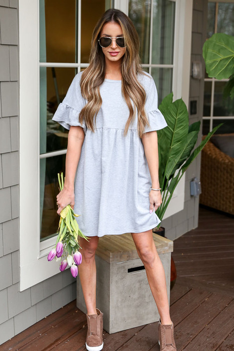 Dress Up model wearing the French Terry Ruffle Sleeve Babydoll Dress with wedge sneakers