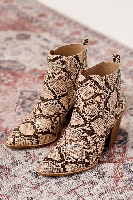 Close up of the Pointed Toe Block Heel Booties in snake on oriental rug from Dress Up Boutique