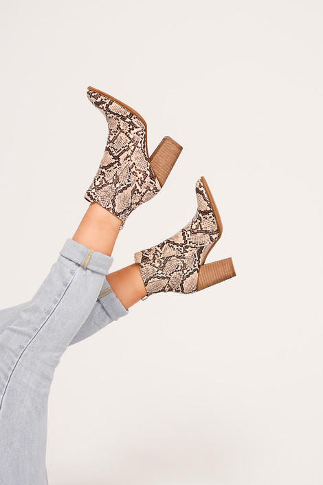 Model wearing the Pointed Toe Block Heel Booties in snake from Dress Up