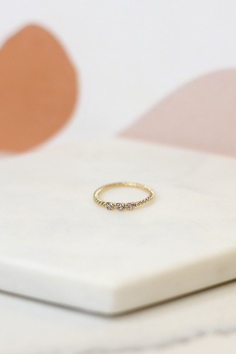 Flat Lay of one of the gold bands in the Rhinestone Ring Set