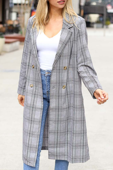 Model wearing the Grey Plaid Longline Blazer with white bodysuit and high rise jeans
