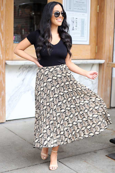 Model from Dress Up wearing the Snakeskin Pleated Midi Skirt with black bodysuit
