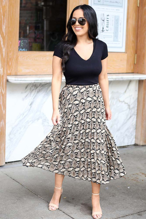 Model from Dress Up wearing the Snakeskin Pleated Midi Skirt with black bodysuit Front View