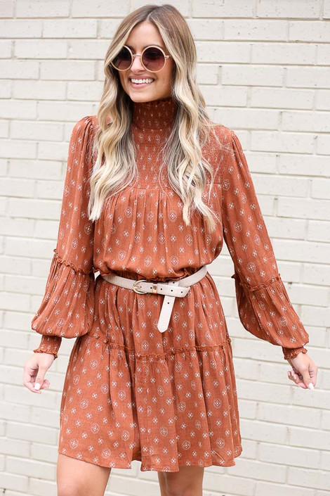 Model wearing the Smocked Mock Neck Tiered Dress with a white belt