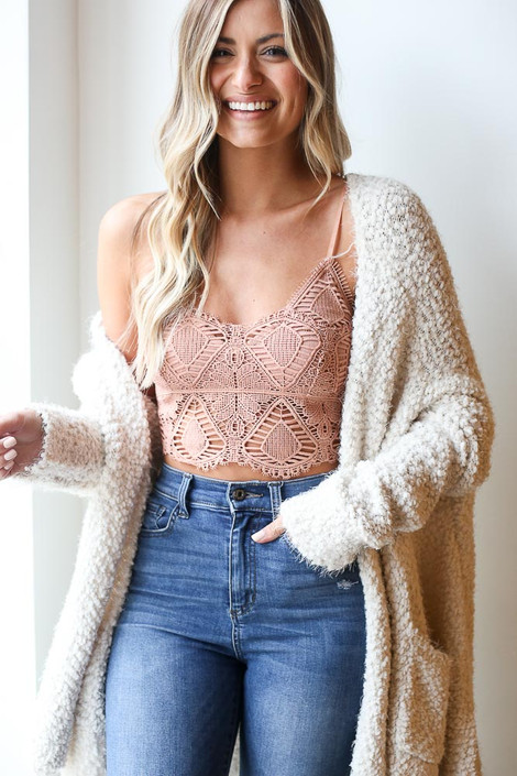 Model wearing the Crochet Bralette in Mauve with lightweight knit cardigan