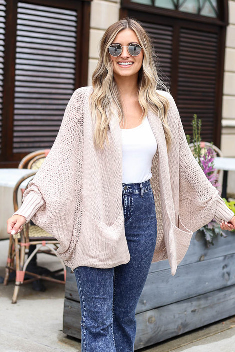 Model wearing the Oversized Knit Cardigan in Ivory with a white tank and dark wash jeans