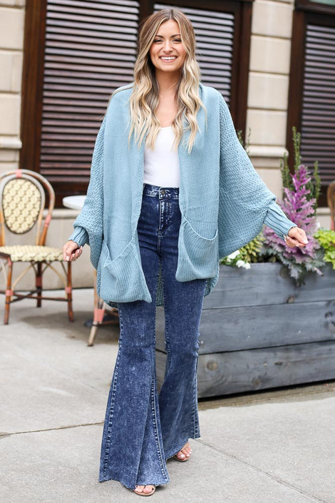 Dress Up model wearing the Oversized Knit Cardigan with flare jeans