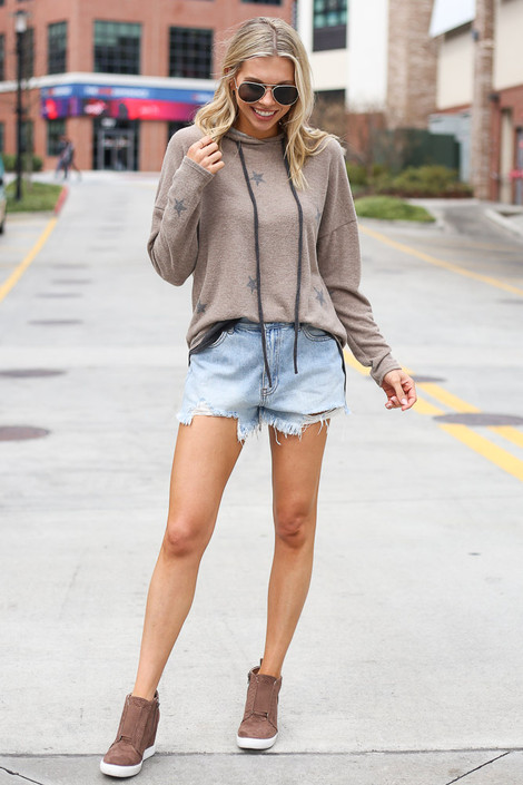 Model wearing the Star Brushed Knit Oversized Hoodie with denim shorts and sneaker wedges