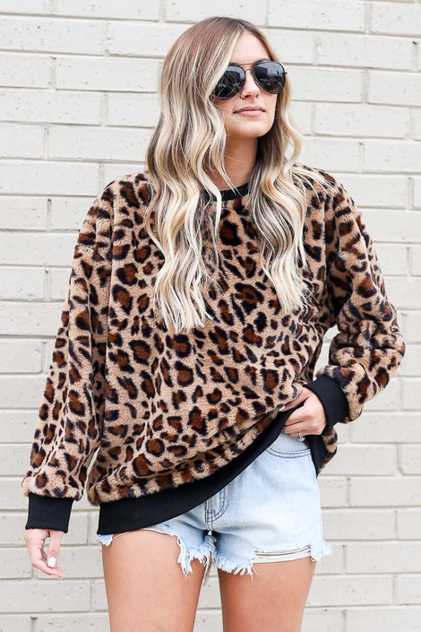 Model wearing the Leopard Faux Fur Pullover with high rise shorts Front View