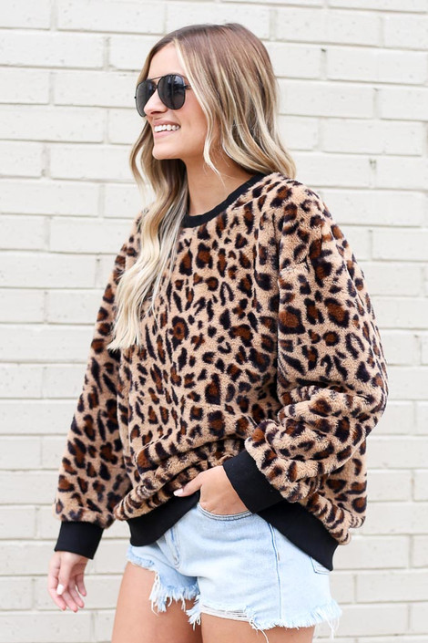 Model wearing the Leopard Faux Fur Pullover with high rise shorts Side View