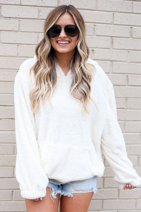 Ivory - Model wearing the Fuzzy Knit Pullover Hoodie