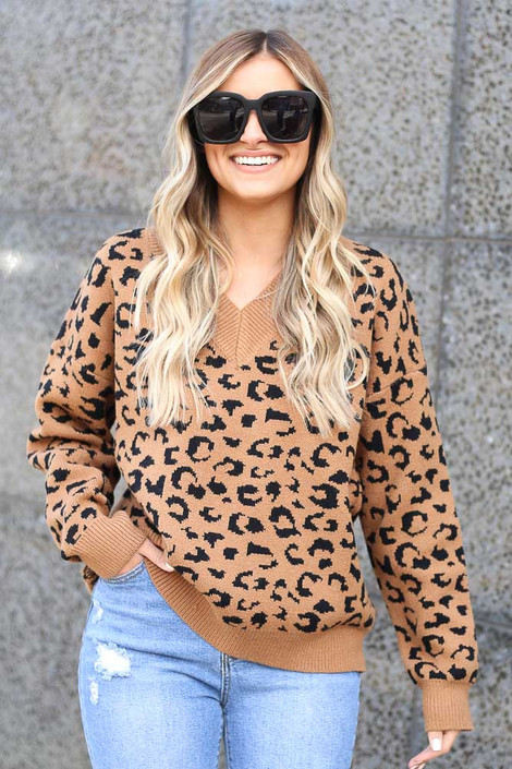 Model wearing the Camel V Neck Leopard Luxe Knit Top with distressed jeans Front View