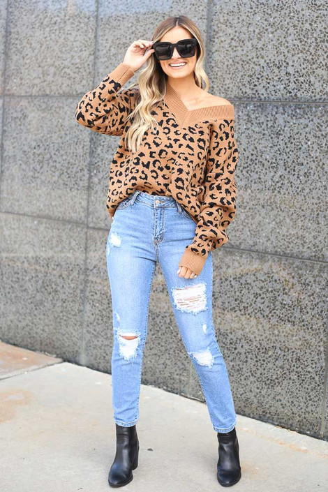 Model wearing the Camel V Neck Leopard Luxe Knit Top with distressed jeans and block heel booties Full Outfit View