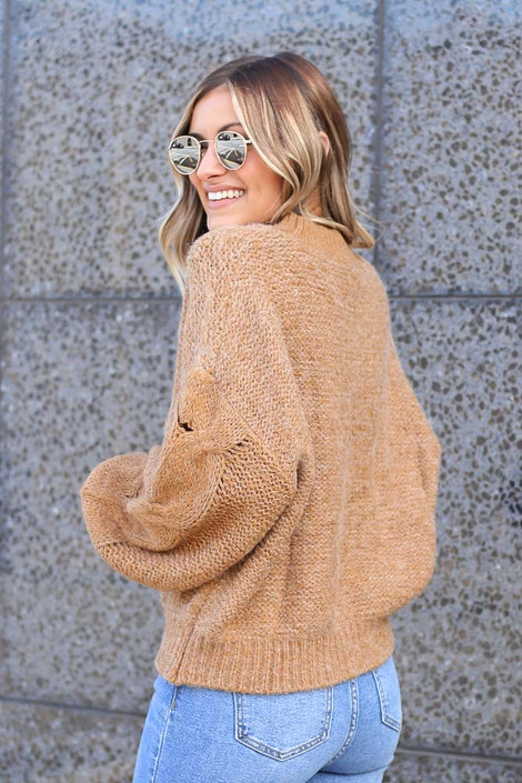 Model wearing the Mock Neck Cable Knit Top in Taupe Side View