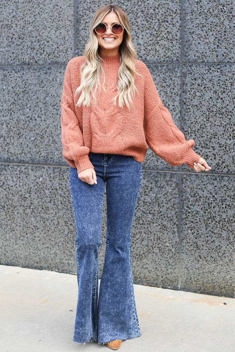 Model wearing the Mock Neck Cable Knit Top in Rust Full View