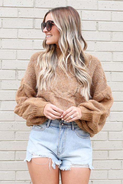 Model wearing the Mock Neck Cable Knit Top in Taupe with high rise shorts