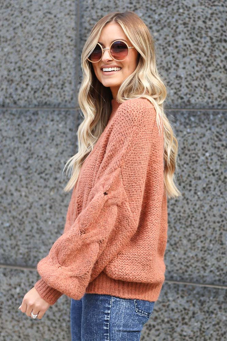 Model wearing the Mock Neck Cable Knit Top in Rust  Side View