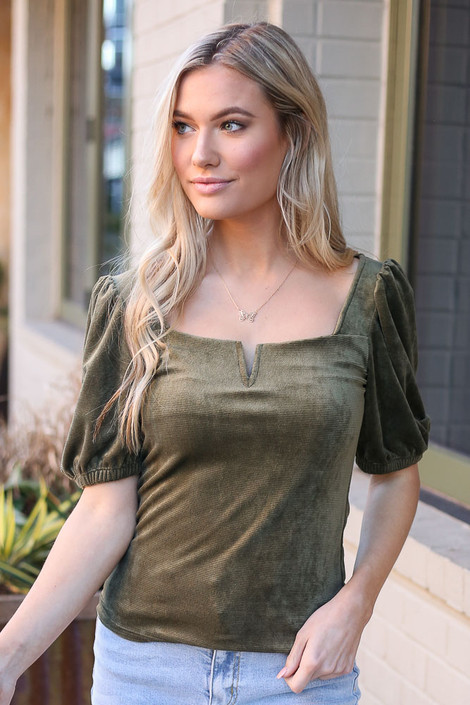 Model wearing the Notched Square Neck Top in Green untucked