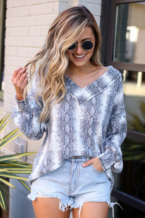 Dress Up model wearing the Snakeskin Waffle Knit V-Neck Top with distressed denim shorts