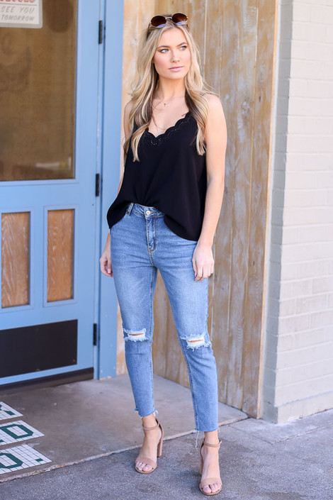 Model wearing Medium Wash High-Rise distressed Mom Jeans front view
