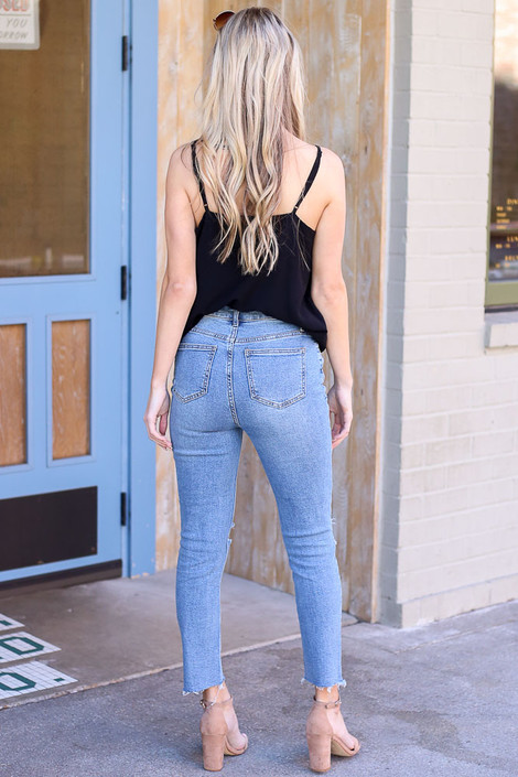 Model wearing Medium Wash High-Rise distressed Mom Jeans back view
