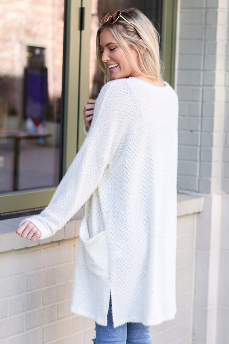 Model wearing the Ivory Fuzzy Knit Cardigan Back View