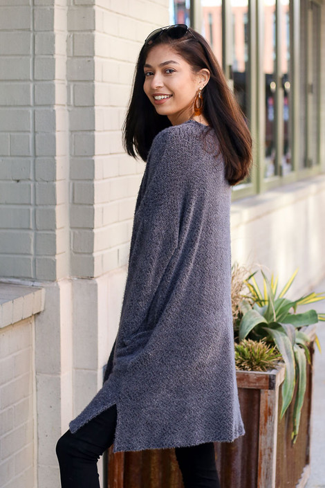 Model wearing the Charcoal Fuzzy Knit Cardigan side view
