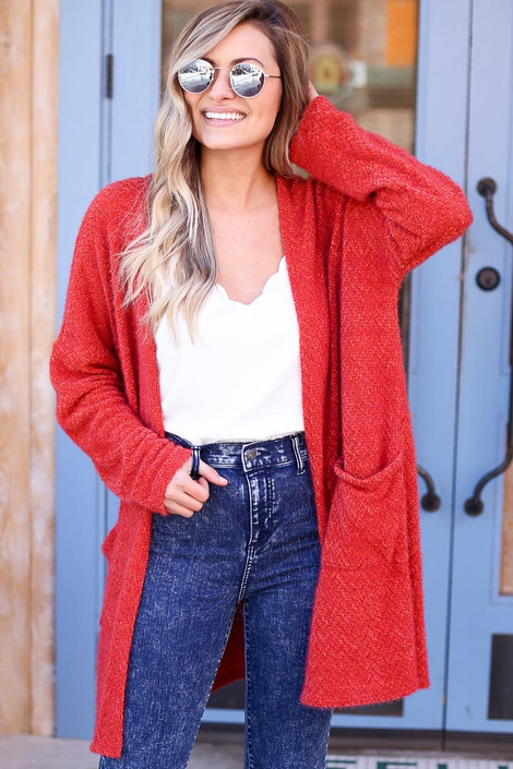 Model wearing the Rust Fuzzy Knit Cardigan with high rise jeans