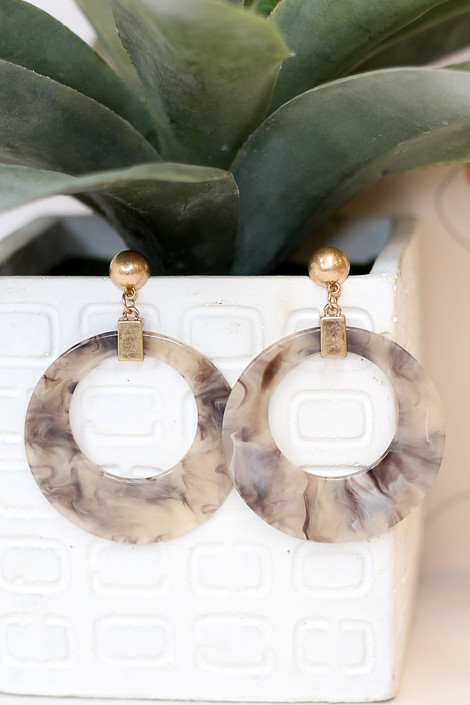 Flat Lay of the Acrylic Statement Earrings in Grey from Dress Up