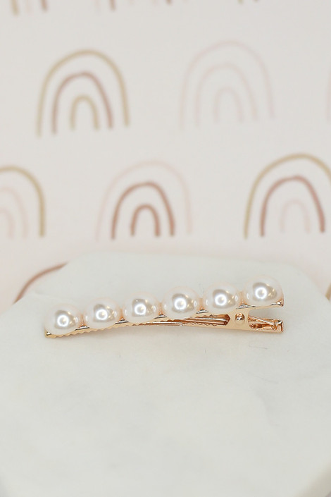 Flat Lay of the Gold Pearl + Rhinestone Hair Clip Set pearl hinge clip