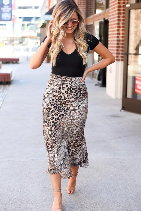 Model wearing the Leopard + Snakeskin Midi Skirt  with black bodysuit and heels from Dress Up