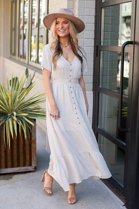 Model wearing the Taupe Ruffle Hem Maxi Dress with wide brim fedora and heels