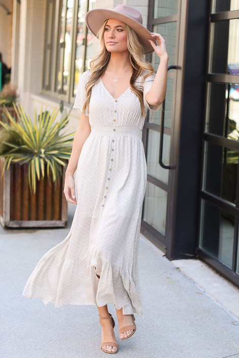 Model wearing the Taupe Ruffle Hem Maxi Dress with wide brim fedora Front View