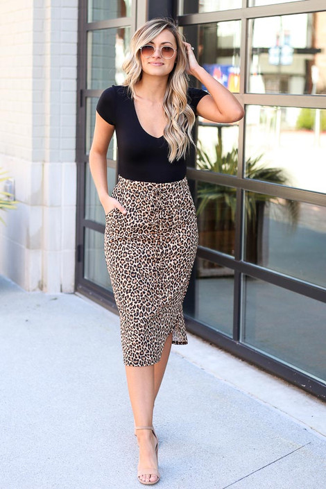Model wearing the Leopard Midi Skirt with black bodysuit and heels