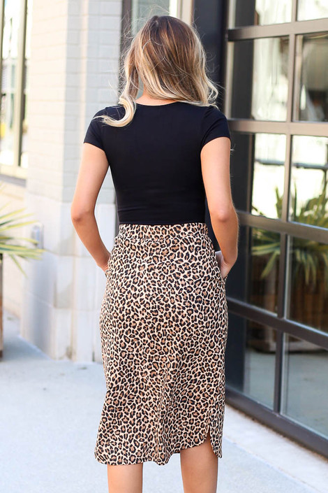 Model wearing the Leopard Midi Skirt with black bodysuit Back View