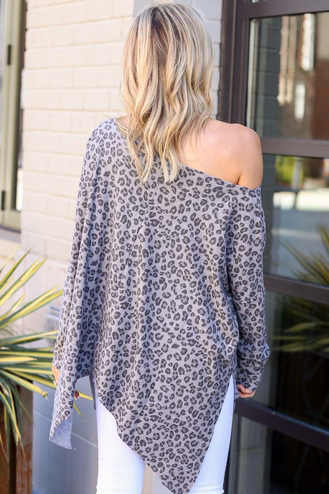 Model wearing the Leopard Print Oversized Top in Grey with white skinny jeans Back View