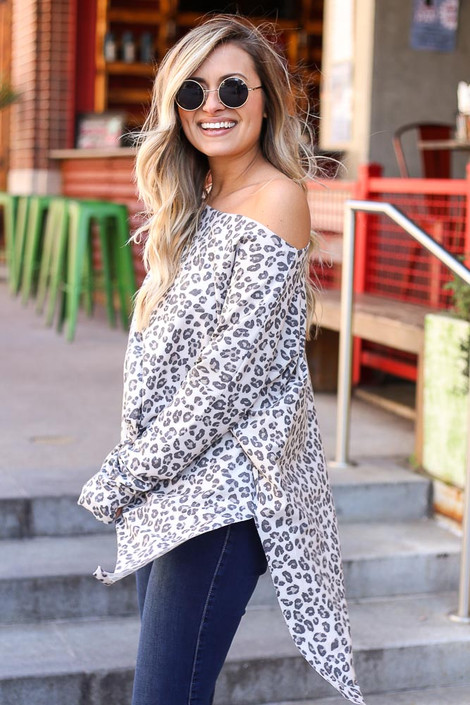 Model wearing the Leopard Print Oversized Top in ivory with high rise jeans Side View