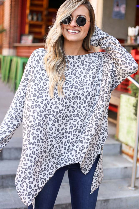 Model wearing the Leopard Print Oversized Top in Ivory with high rise skinny jeans